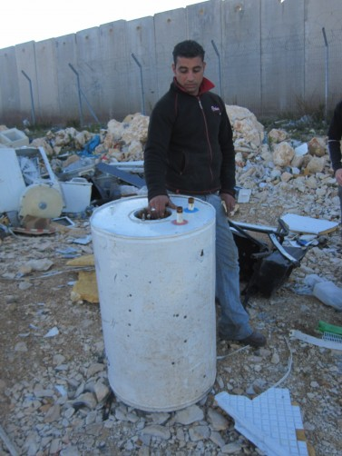 IMG 1474 e1322645765221 377x502 Palestinian Recycler with a water heater by the wall, Pisgat  Zeev, Jerusalem